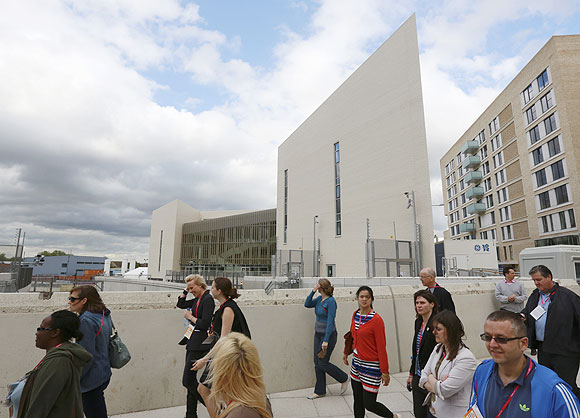 Visitors pass the medical centre in the Olympic Village