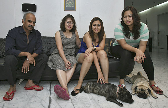 India's badminton player Jwala Gutta (centre) with her sister Insi Gutta (right), mother Yelan Gutta (2nd from left) and father Kranti Gutta