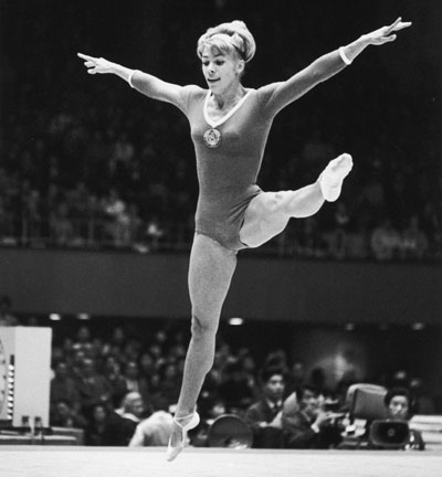 Soviet gymnast Larissa Latynina of the Ukraine in action during the women's compulsory exercises at the Tokyo Olympics