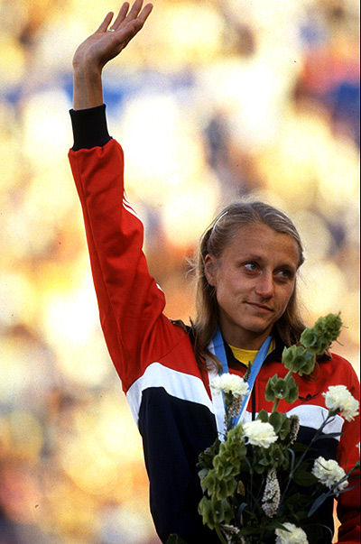 Grete Waitz of Norway waves to the crowd after receiving the gold medal for the Marathon event during the World Championships at the Olympic Stadium in Helsinki