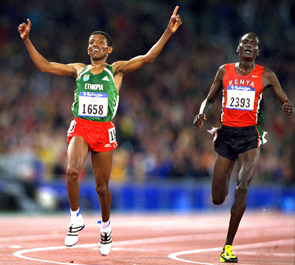 Haile Gebrselassie of Ethiopia beats Paul Tergat of Kenya (right) in the Mens 10000m Final at the Olympic Stadium on Day Ten of the Sydney 2000 Olympic Games in Sydney