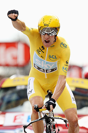 Bradley Wiggins of Great Britain and SKY Procycling punches the air with delight as he celebrates winning the 19th stage and securing the yellow jersey of the general classification of the 2012 Tour de France on Saturday