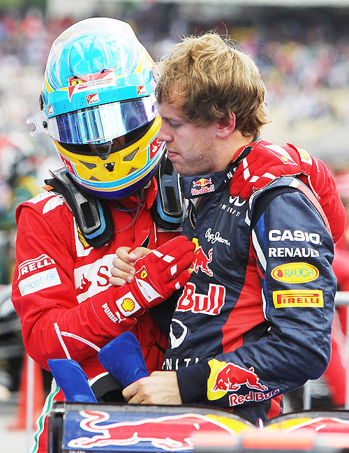 Race winner Fernando Alonso (left) celebrates with second placed Sebastian Vettel