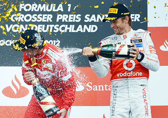 Fernando Alonso (left) with third placed Jenson Button