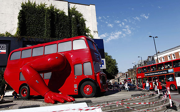 A London bus that has been transformed into a robotic sculpture by Czech artist David Cerny is assembled in front of the Czech Olympic headquarters in London