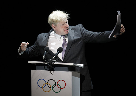 London mayor Boris Johnson, recites a Pindaric Ode for the 2012 Olympic Games during the Opening Ceremony of the International Olympic Committee session at London's Royal Opera House, on Monday