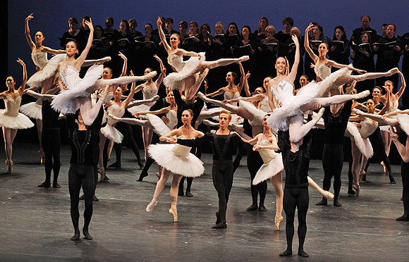 Ballet dancers perform on stage during the opening ceremony of the International Olympic Committee session in central London's Royal Opera House, Monday