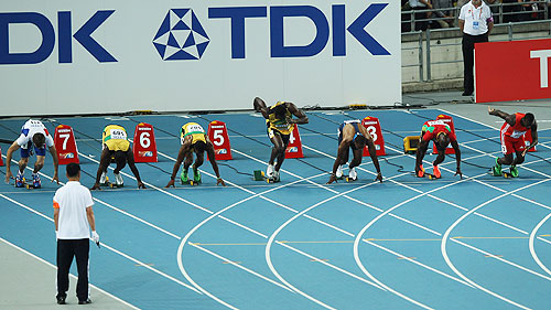 Usain Bolt of Jamaica (4th left) makes a false start