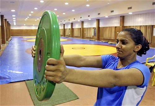 Indian wrestler Geeta Phogat, who is supported by Mittal Champions Trust, trains at a gym
