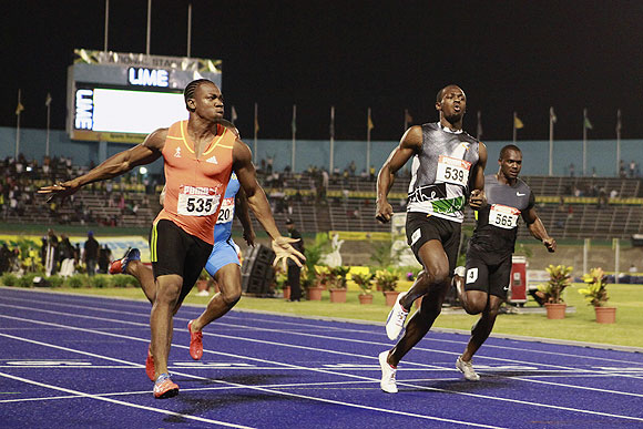 Yohan Blake (left) pips Usain Bolt to the finish line during the men's 100 meters final event at the Jamaican Olympic trials last month