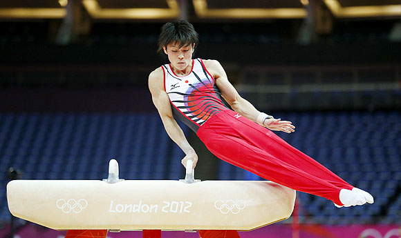 Kohei Uchimura of Japan practices on the pommel horse during a training session at the O2 Arena in London