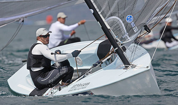 Britain's Ben Ainslie, who is competing in the Finn class, takes part in a practice race during the Weymouth and Portland International Regatta