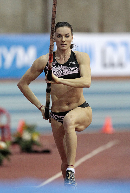 Yelena Isinbayeva of Russia competes in the women's pole vault event