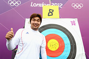 Im Dong Hyun of Korea celebrates breaking the World Record during the Men's Individual Archery Ranking Round on Olympics Opening Day
