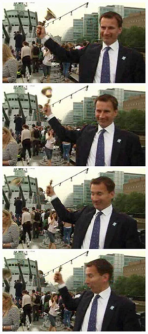 A combination of still images taken from a video grab shows British Secretary of State for Culture, Olympics, Media and Sport Jeremy Hunt ringing an Olympic bell which flew off its handle in London on Friday