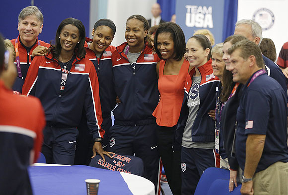 US first lady Michelle Obama (centre) poses for a photo with members of the women's basketball team after speaking at a breakfast with Team USA in London on Friday