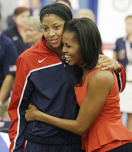 First lady Michelle Obama hugs women's basketball player Candace Parker after speaking at a breakfast with Team USA in London on Friday