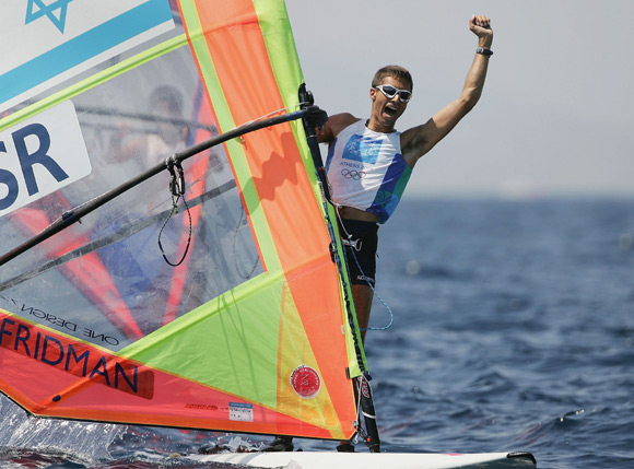 Gal Fridman of Israel celebrates his gold medal  in the men's windsurfer mistral finals race during the Athens 2004 Summer Olympic Games