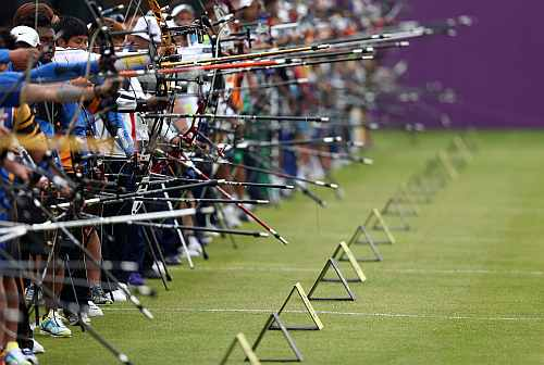 Competitors take aim during the Archery Ranking Round on Olympics Opening Day as part of the London 2012 Olympic Games at the Lord's Cricket Ground