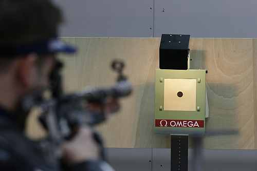 An Olympic shooting athlete trains for the 10-meter air rifle event, at the Royal Artillery Barracks