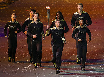 The seven British athlete representing Britain's hopes for the next Olympics run with the Olympic torch during the Opening Ceremony of the London Olympic Games on  Friday