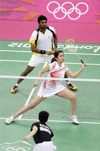 India's Jwala Gutta, center, play with teammate V Diju