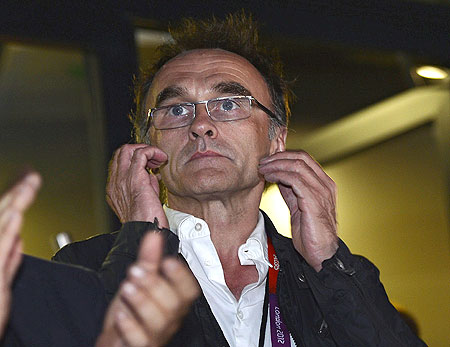 Danny Boyle, the director of the London Olympic Games opening ceremony watches the ceremony at the Olympic Stadium on Friday