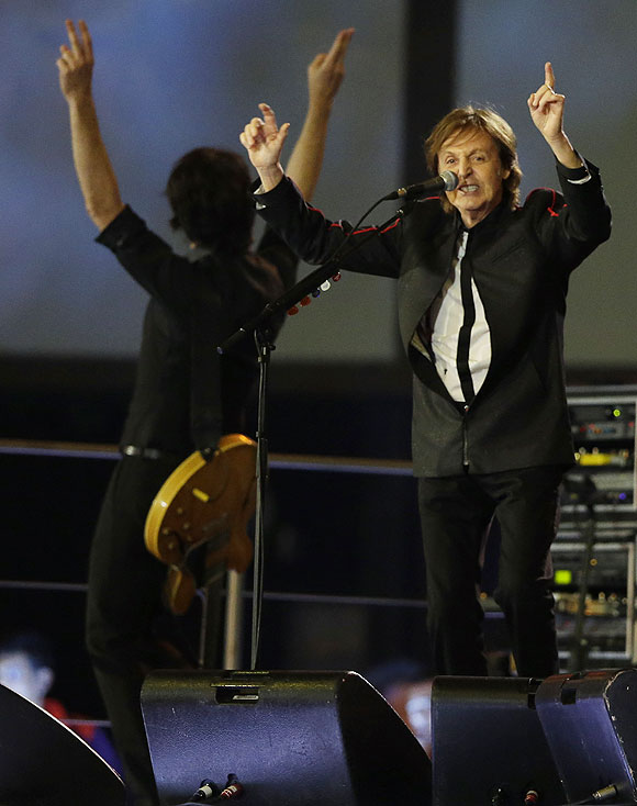 Sir Paul McCartney performs during the Opening Ceremony of the London Olympics on Friday