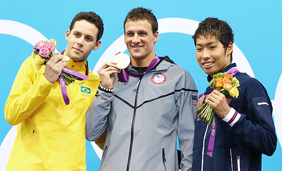 Silver medallist Thiago Pereira of Brazil (left) gold medallist Ryan Lochte of the United States and bronze medallist Kosuke Hagino of Japan celebrate on the podium after winning the 400m individual medley