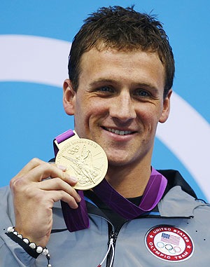 Ryan Lochte of the U.S. holds his gold medal for the men's 400m individual medley during the London 2012 Olympic Games at the Aquatics Centre on Sunday
