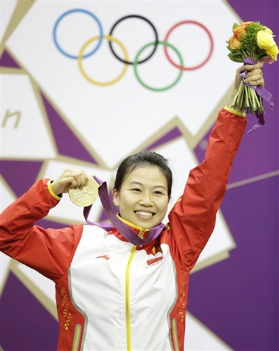 China's Yi Siling celebrates after winning the gold medal