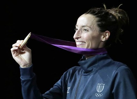 Italy's gold medalist Elisa Di Francisca shows off her medal