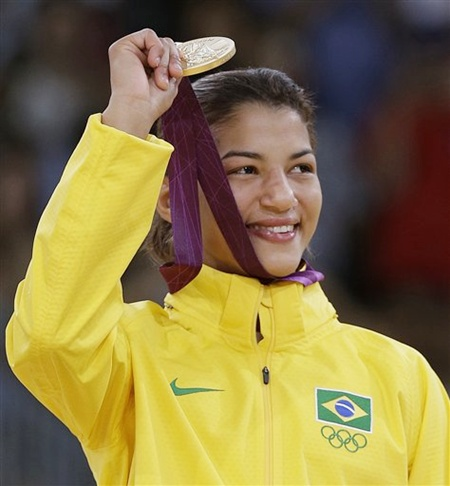 Sarah Menezes of Brazil holds up her gold medal