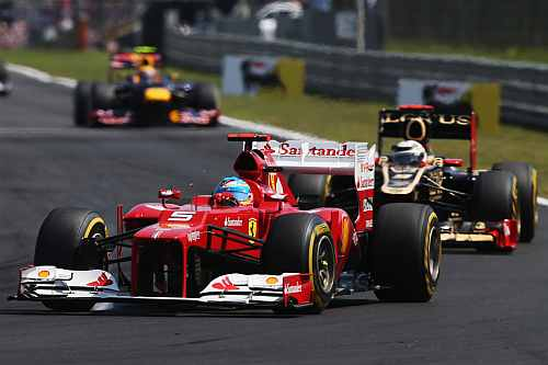 Fernando Alonso of Spain and Ferrari leads from Kimi Raikkonen of Finland and Lotus during the Hungarian Formula One Grand Prix