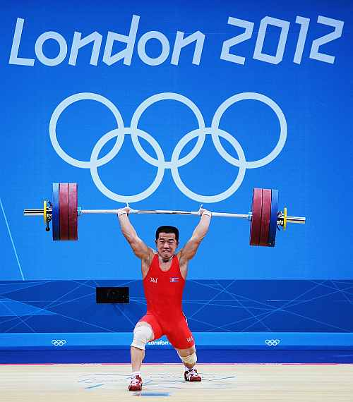 Yun Chol Om of DPR Korea celebrates breaking the Olympic Record in the Mens 56kg Group B weightlifting of the London 2012 Olympic Games