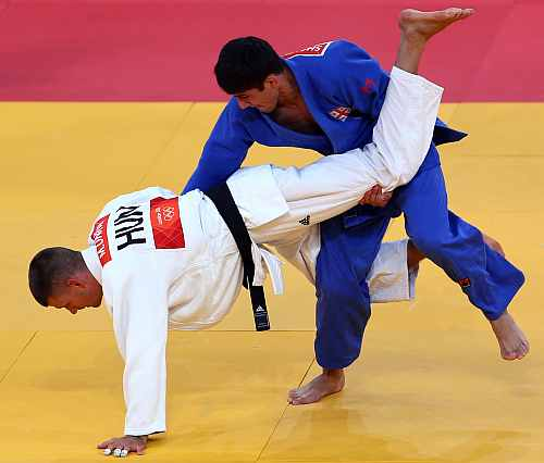 Lasha Shavdatuashvili of Georgia competes with Miklos Ungvari of Hungary for the gold medal in Men's -66 kg Judo of the London 2012 Olympic Games