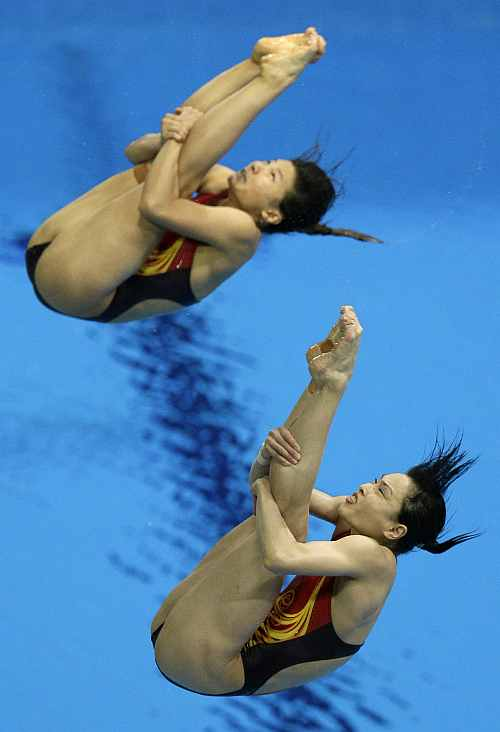 Gold medalists Wu Minxia, front, and He Zi, rear, compete during the 3 Meter Synchronized Springboard final at the Aquatics Centre in the Olympic Park