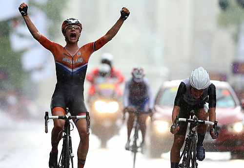 Marianne Vos of Netherlands (L) celebrates as she crosses the finish line ahead of Elizabeth Armitstead of Great Britain (R) to win the Women's Road Race Road Cycling