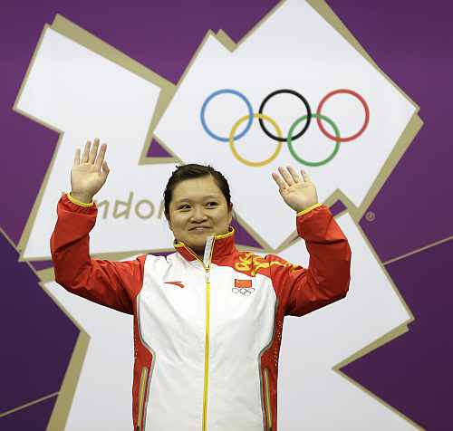 China's Guo Wenjun celebrates after winning the gold medal in the women's 10-meter air pistol event