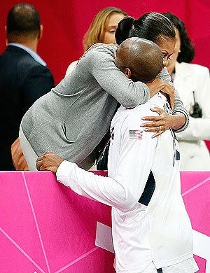 First Lady Michelle Obama hugs US basketball star Kobe Bryant after their match against France on Sunday