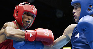 Great Britain's Josh Taylor, right, fights Brazil's Robson Conceicao during a lightweight 60-kg preliminary boxing match at the London Games on Sunday