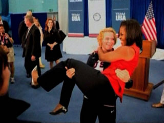 Michelle Obama is carried by US lifter Elena Pirozhkova
