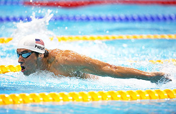 Michael Phelps of the United States competes in heat 5 of the Men's 200m Butterfly on Monday