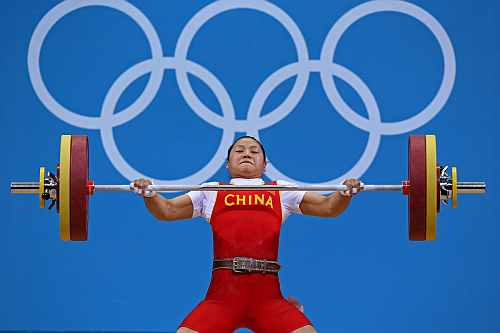 China's Xueying Li lifts 108 Kg on snatch setting new Olympic record on the women's 58Kg Group A weightlifting competition