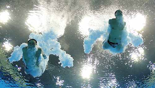 Yuan Cao and Yanquan Zhang of China compete in the Men's Synchronised 10m Platform Diving