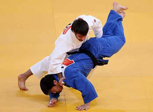 Mansur Isaev of Russia (white) competes for the gold medal with Misato Nakamura of Japan during the Men's 73 kg Judo