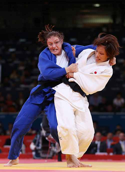 Kaori Matsumoto of Japan competes against Corina Caprioriu of Romania in the Women's -57 kg Judo