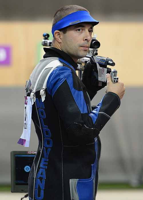 Alin George Moldoveanu of Romania competes in the Men's 10m Air Rifle Shooting final