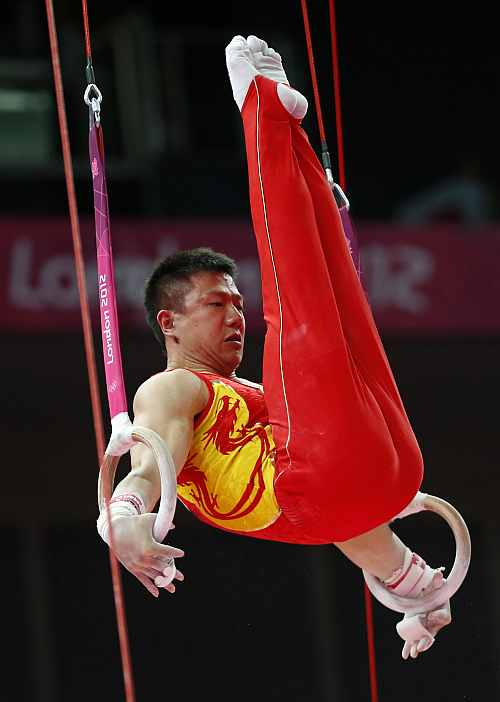 Chinese gymnast Chen Yibing performs on the rings during the Artistic Gymnastic men's team final