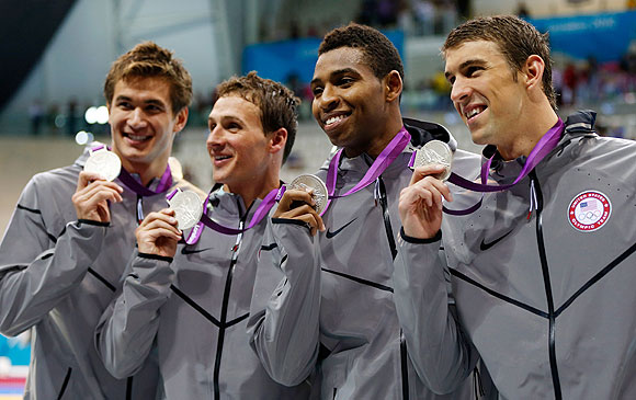 Adrian Nathan, Ryan Lochte, Cullen Jones and Michael Phelps of the United States pose with the silver medals won during the Men's 4 x 100m Freestyle Relay final on at the Aquatics Centre on Sunday